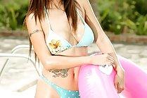 Big tits Jenny Lee strips bikini at swimming pool and poses nude