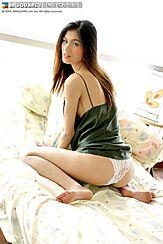 Kneeling On Bed Panties Exposed Long Hair