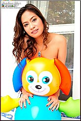 Mounting Toy From Behind Smiling Doggy Bare Left Shoulder