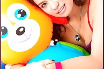 Busty Angelena Loly poses with stuffed toy and plays with toy