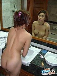 Washing Her Hands On Wash Basin Big Breasts