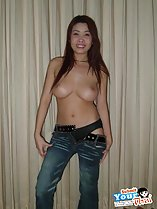 Pulling her trousers down long hair big breasts