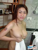 Holding towel cupping her big breasts tattoo on her arm