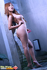 On Tiptoes Naked Beside Wall Hand On Hip Long Hair Pert Big Tits Nice Ass Bare Feet