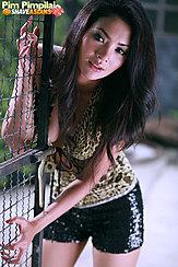 Pim Pimpilai Leaning Against Metal Gate Long Hair Wearing Shorts Painted Fingernails