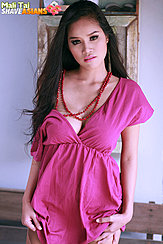 Mali Tai With Long Hair Over Her Shoulder Wearing Dress