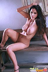 Mali Tai Seated Naked On Wooden Bench Pushing Her Long Hair Back Big Breasts Wearing High Heels