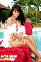 sitting on lounger white feather boa