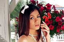 Busty Thai babe Natt Chanapa strips dress and bares sweet curves
