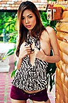 May Supha Wearing Zebra Print Top And Purple Shorts Long Auburn Hair