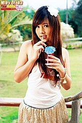 Miky Otaka Sipping Drink Through Straw