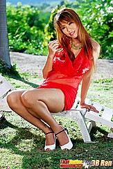 Bb Ran Sitting On Lounger Wearing Red Dress And White Heels