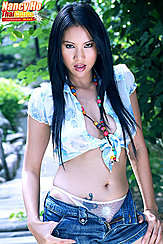 Nancy Ho Standing With Hands On Hips Long Hair Wearing Blue Knotted Shirt And Denim Shorts
