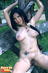 Seated With Her Legs Spread On Bench Exposing Her Pussy Arms Raised Long Hair Trailing Over Her Big Tits