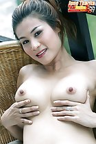 Seated on chair cupping her breasts
