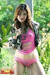 Pulling Her Jacket Close Wearing Pink Top And Mesh Panties