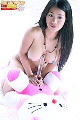 Holding Dildo Between Her Big Tits Leaning On Hello Kitty