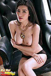 Seated Topless Arms Folded Under Her Big Tits Wearing Black Panties