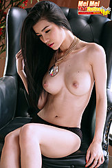 Sitting On Leather Chair Topless In Panties Hand On Her Long Hair