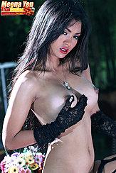 Meena Yen Cupping Her Big Breasts Long Hair Falling Over Her Shoulders