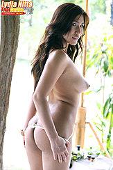 Pulling Her Panties Down Topless Nice Ass Big Tits Long Hair