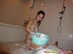 Kneeling Tub Of Soapy Water On Her Lap