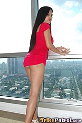 Leaning Against Window Overlooking City Long Hair Red Dress Riding Up Over Her Ass